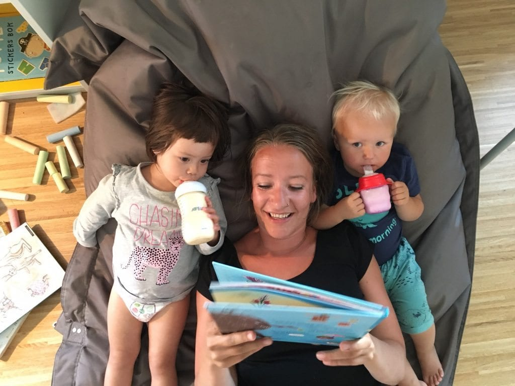 Kari, Saga and Naomi drinking milk and reading